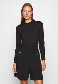 Calvin Klein - LIQUID TOUCH TURTLE NECK - Long sleeved top - black - 0