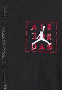 Jordan - Training jacket - black/dark smoke grey - 2