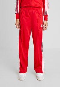 adidas Originals - FIREBIRD ADICOLOR TRACK PANTS - Træningsbukser - scarlet - 0