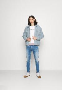 Tommy Jeans - SIMON SKINNY - Flared Jeans - denim - 1