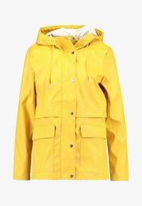 ONLTRAIN SHORT - Waterproof jacket - yolk yellow