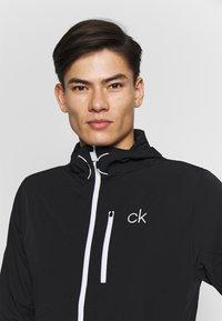 Calvin Klein Golf - ULTRALITE JACKET - Verryttelytakki - black - 3