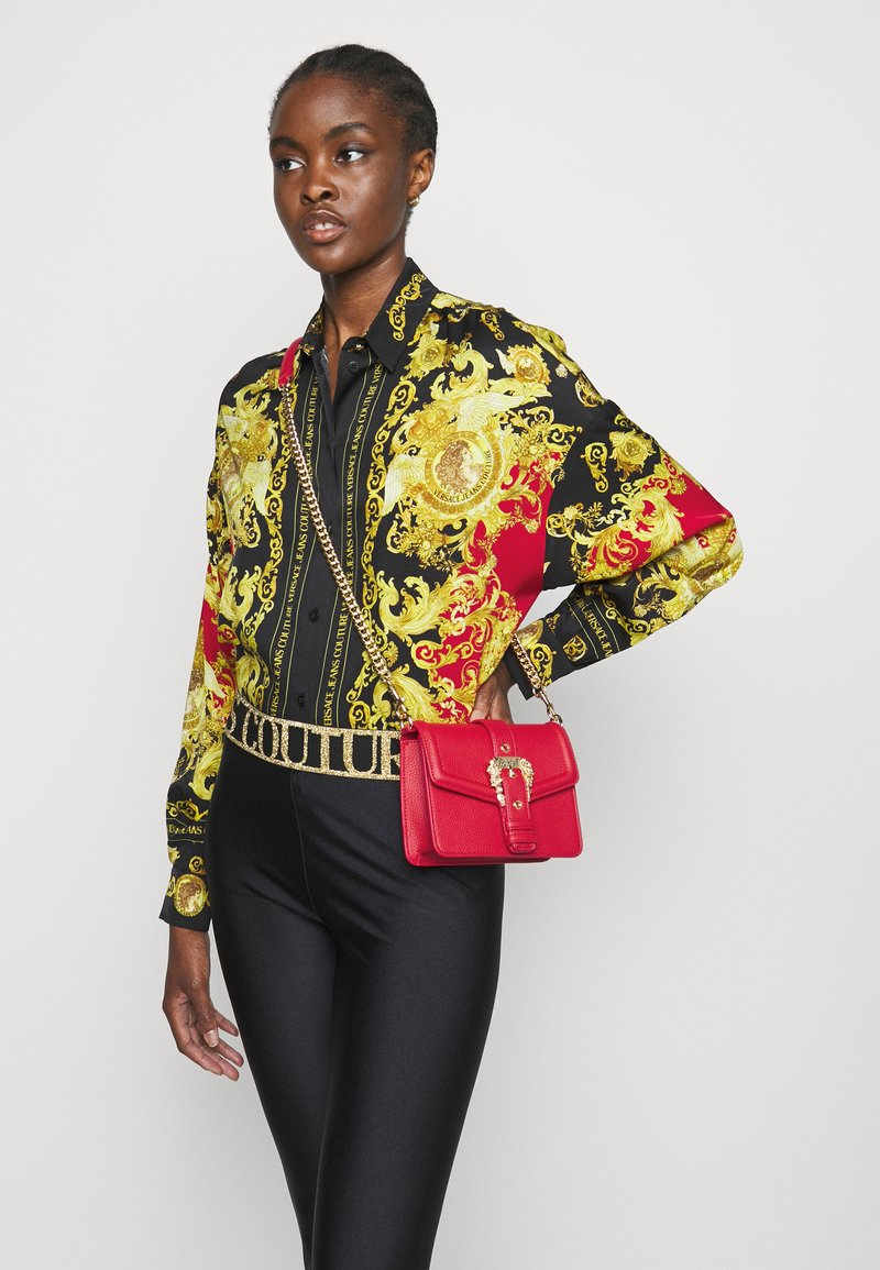 Versace Jeans Couture - COUTURE DISCOBAG - Across body bag - rosso
