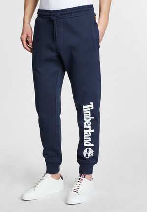 CORE TREE  - Tracksuit bottoms - dark sapphirewhite