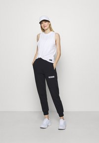 Calvin Klein Performance - PANT - Tracksuit bottoms - black - 1