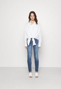 Liu Jo Jeans - MAGNETIC - Straight leg jeans - denim blue join wash - 1