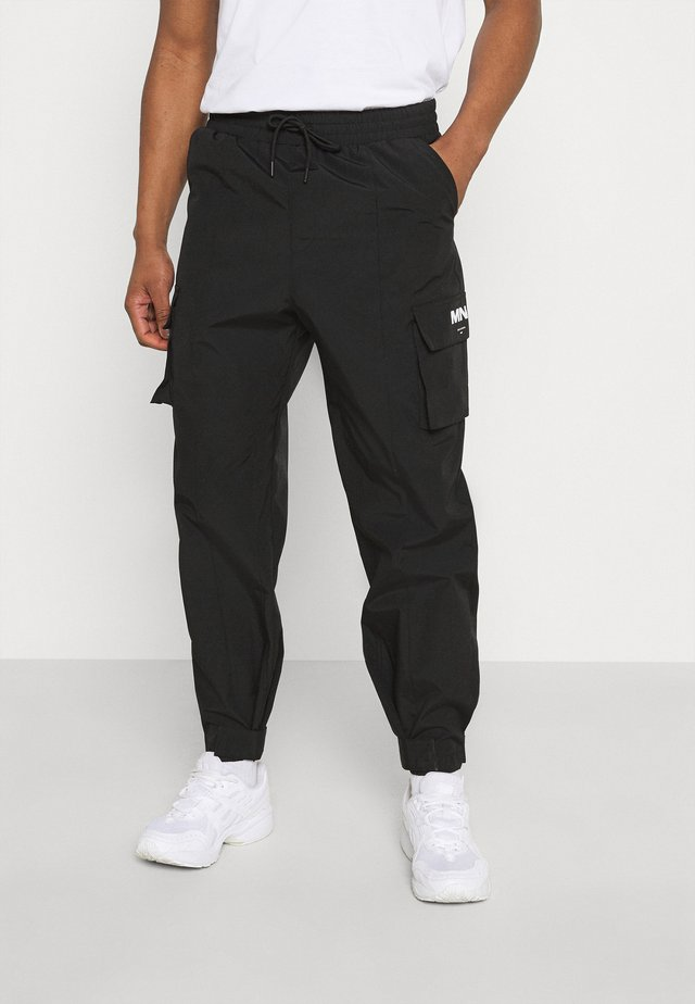 TRACKSUIT BOTTOM - Trainingsbroek - black