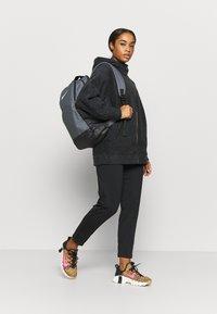 Nike Performance - COZY - Fleece jacket - black/metallic gold - 1