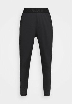 BAR - Pantalones deportivos - black/white