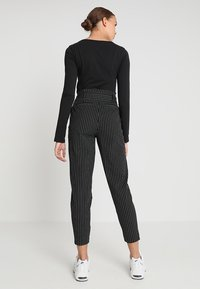 ONLY - ONLNICOLE PINSTRIPE PANTS - Stoffhose - black - 2