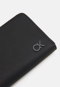 Calvin Klein - LONG ZIPAROUND - Wallet - black - 4