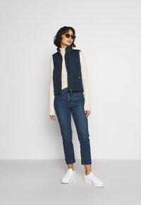 GAP Petite - CIGARETTE GLYDE - Slim fit jeans - dark indigo - 1
