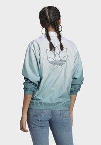 adidas Originals - Light jacket - white - 2