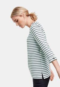 Taifun - Long sleeved top - off-white /black ringel - 1