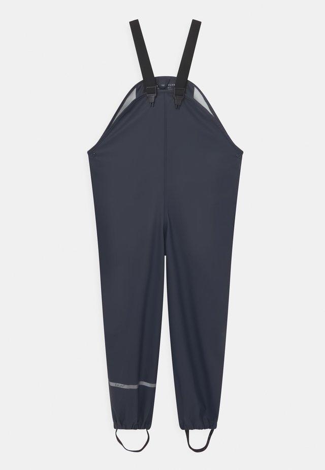 BASIC RAIN UNISEX - Rain trousers - dark navy