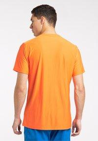 Haglöfs - Print T-shirt - flame orange - 1
