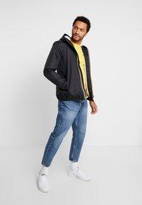 K-Way - UNISEX CLAUDE ORESETTO - Light jacket - black - 1