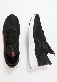 Puma - SOFTRIDE RIFT - Hardloopschoenen neutraal - black/high risk red - 1