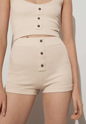 SEAMLESS - Pants - beige