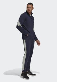 adidas Performance - Cotton TS TRACKSUITS SPORTS TOP:REGULAR-BOTTOM:REGULAR TRACKSUIT - Chándal - blue - 1