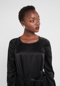 Bruuns Bazaar - PHILOSOPHY NILE DRESS - Koktejlové šaty/ šaty na párty - black - 3