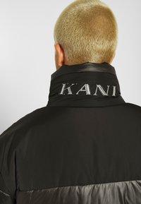 Karl Kani - OG REVERSIBLE CAMO PUFFER JACKET - Winter jacket - black - 4