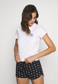 Calvin Klein Underwear - CK ONE LOUNGE CREW NECK - Pyjama top - white - 0