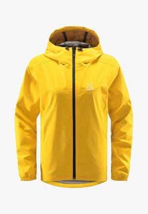 BUTEO JACKET - Hardshell jacket - pumpkin yellow