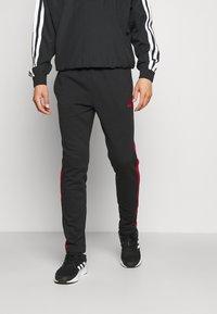 adidas Performance - Träningsbyxor - black/scarlet - 0