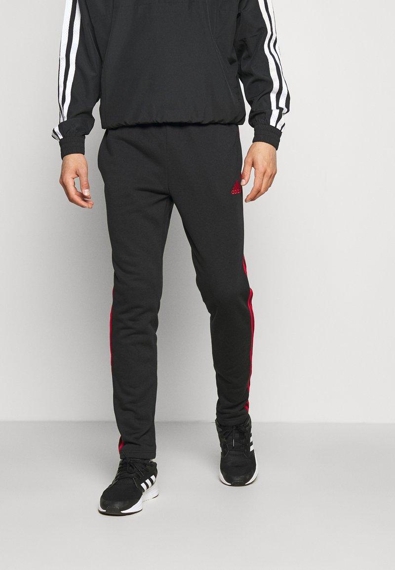 adidas Performance - Träningsbyxor - black/scarlet