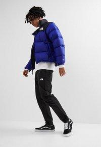 The North Face - TECH PANT - Spodnie treningowe - black/white - 1