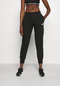 Puma - Pantalon de survêtement - black - 0