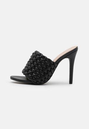 TANYA - Heeled mules - black