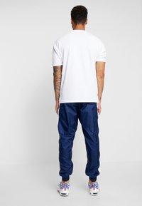 Nike Sportswear - Tracksuit - midnight navy/white - 5