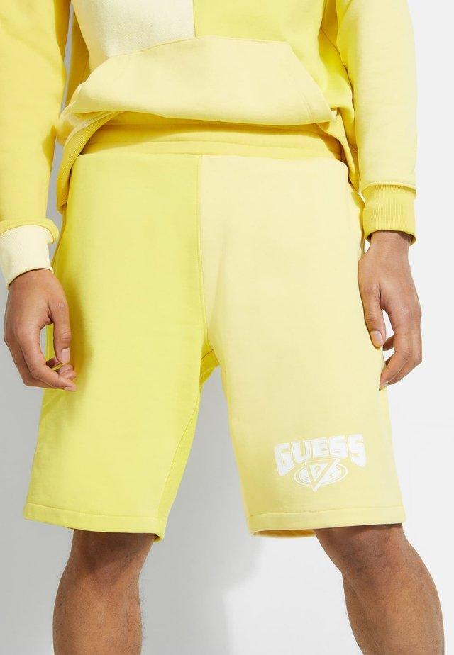 Pantaloncini sportivi - gelb