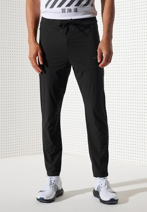 RUN JOGGERS - Tracksuit bottoms - black