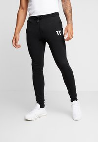 11 DEGREES - CORE JOGGERS  - Spodnie treningowe - black - 0