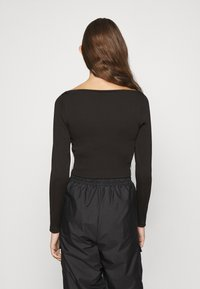 Puma - CLASSICS LONGSLEEVE CROPPED - Long sleeved top - black - 2