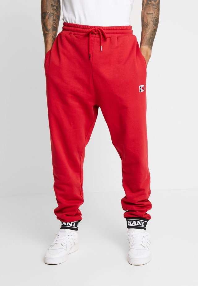 RETRO TRACKPANTS - Verryttelyhousut - red