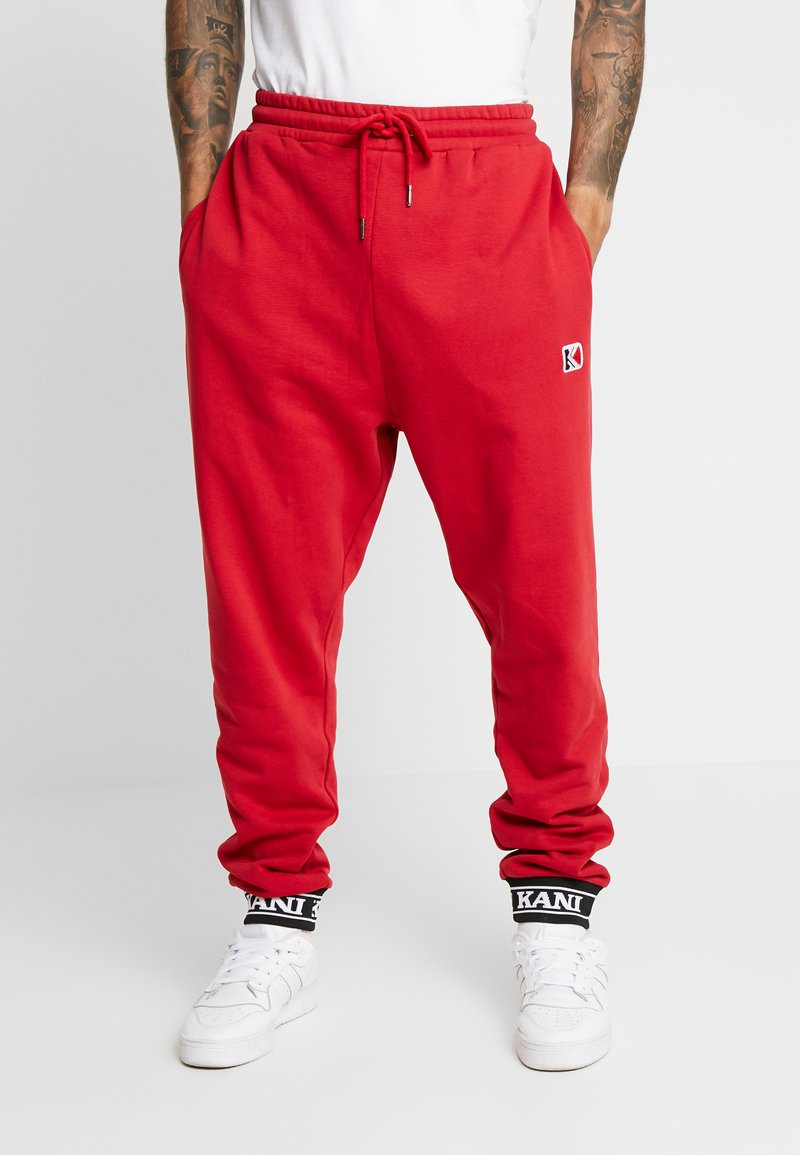Karl Kani - RETRO TRACKPANTS - Pantalon de survêtement - red