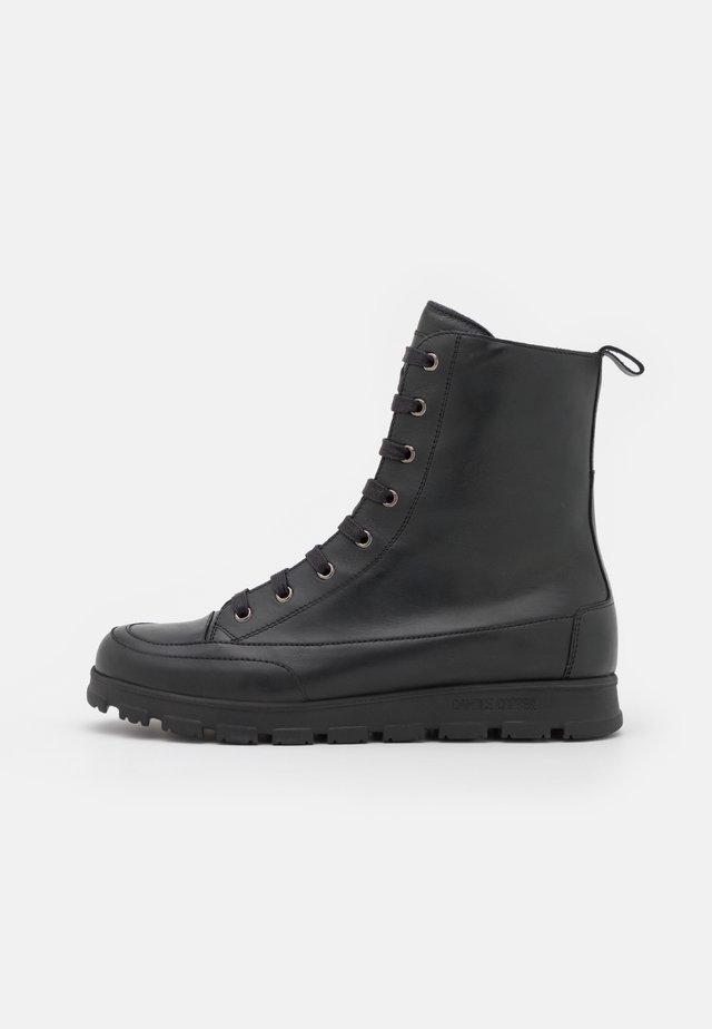 NINJA COMMANDO - Lace-up ankle boots - nero
