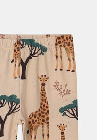 Walkiddy - GIRAFFES UNISEX - Leggings - Trousers - orange - 2