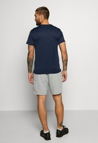 Nike Performance - Print T-shirt - obsidian/white - 2