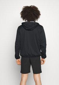 Calvin Klein Golf - ULTRON HOODED JACKET - Waterproof jacket - navy - 2