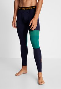 Nike Performance - Legginsy - blackened blue/mystic green/kumquat - 3