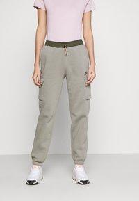 Nike Sportswear - PANT - Tracksuit bottoms - light army/cargo khaki - 0