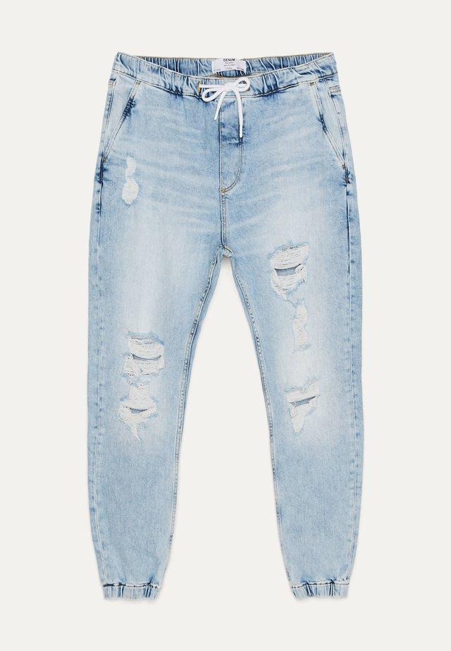 MIT RISSEN - Jeans Tapered Fit - blue
