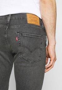 Levi's® - 502 TAPER - Slim fit jeans - blacks - 4