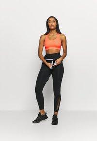 Nike Performance - BRA - Sujetadores deportivos con sujeción media - bright mango/white - 1