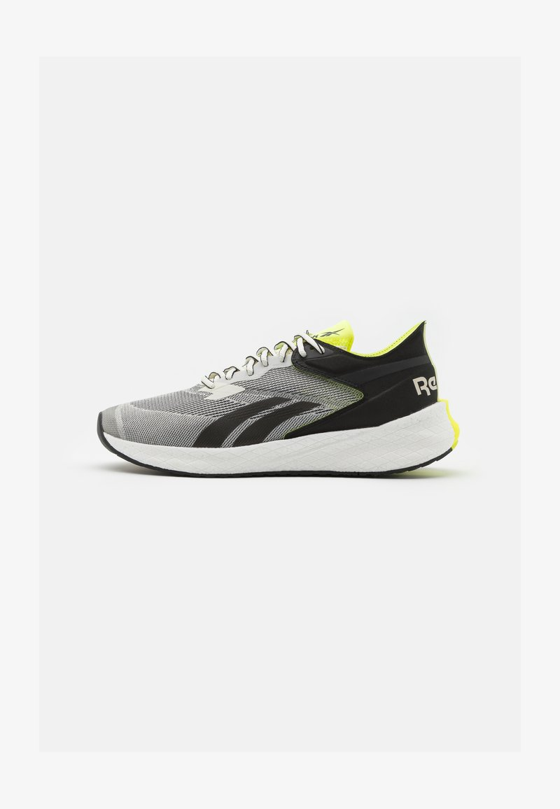 Reebok - FLOATRIDE ENERGY SYMMETROS SHOES - Neutral running shoes - clay white/core black/yellow fluo